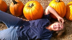 Janis lying in pumpkin patch